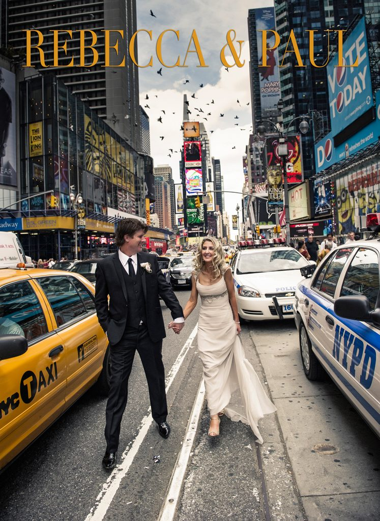 smiling couple on wedding day. walking on the road in new york city, between a yellow cab and a police car.
