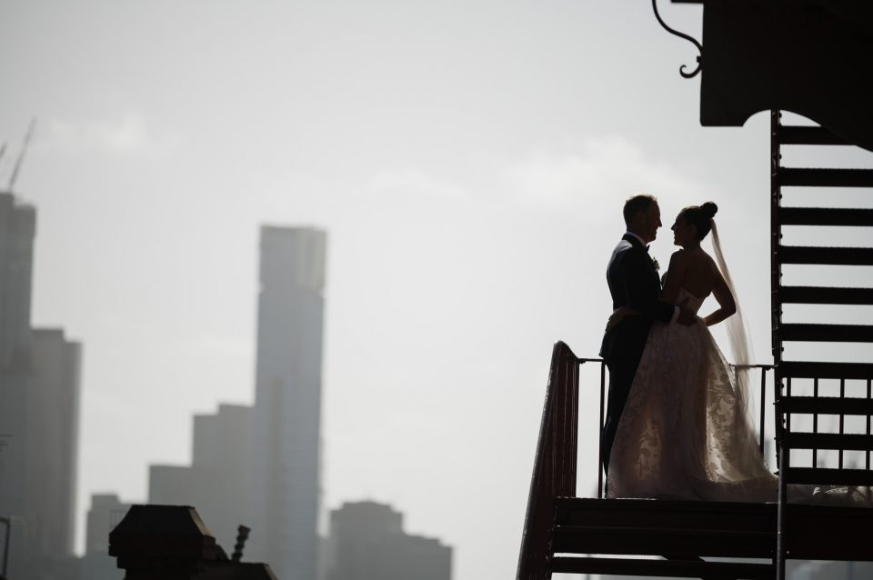 Bride and Groom silhouetted against the melbourne city skyline