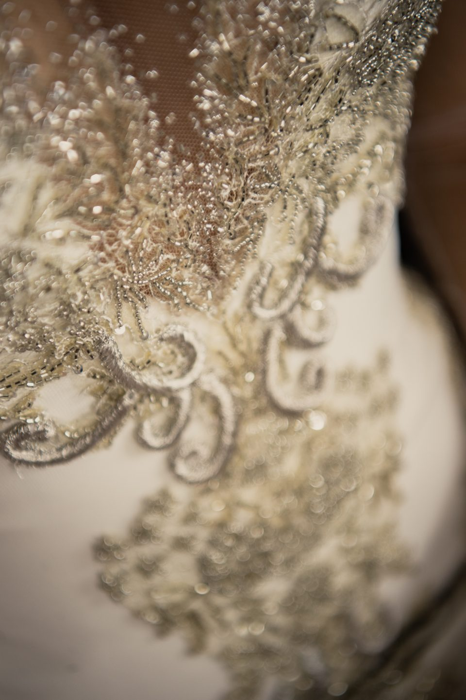 Close detail photograph of Annette of Melbourne wedding dress, showing silver embroidery and beading