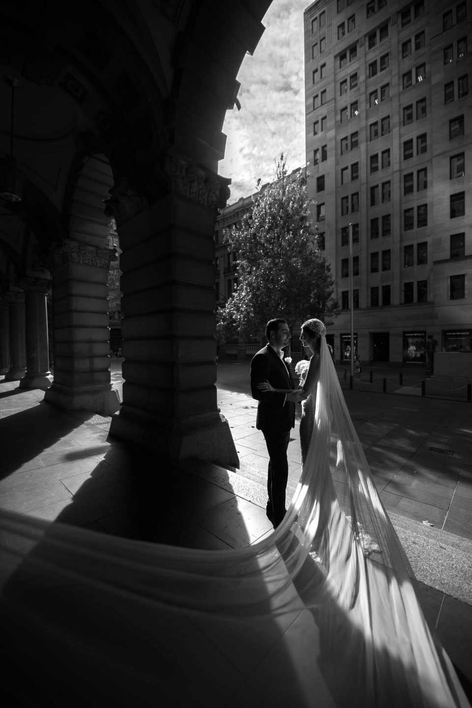 black and white wedding photo with long veil