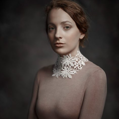 Portrait known as Seren, by Melbourne wedding photographer Rocco Ancora. Dressed an white lace collared top, lit with a broad lighting technique