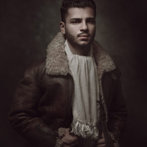 Photograph 'The Aviator' taken by Melbourne photographer. Subject is wearing genuine WW2 Airforce attire, leather jacket and woven cream scarf